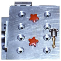 Gravity Rotation Mould for lead battery terminals for Armoured Fighting Vehicles.